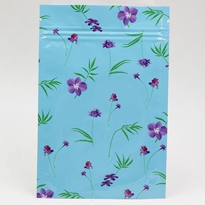 ซองซิปลายดอกไม้สีม่วงพื้นหลังสีฟ้า ขนาด 10x15 cm. 100 ชิ้น
