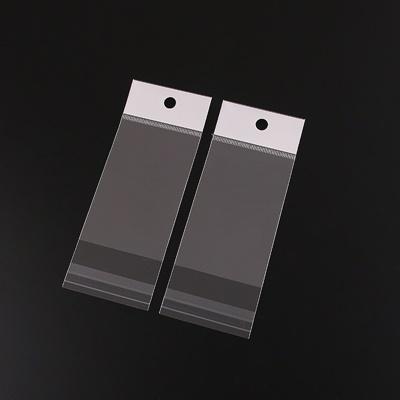 ถุงพลาสติกแถบขาวมีรูแขวนแบบมีเทปกาว 10x18 cm. 100 ชิ้น