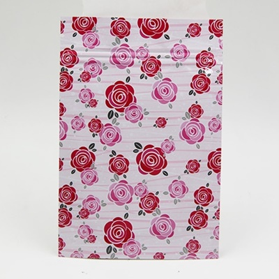 ซองซิปลายดอกกุหลาบสีแดงชมพูพื้นหลังสีขาว ขนาด 8x12 cm. 100 ชิ้น