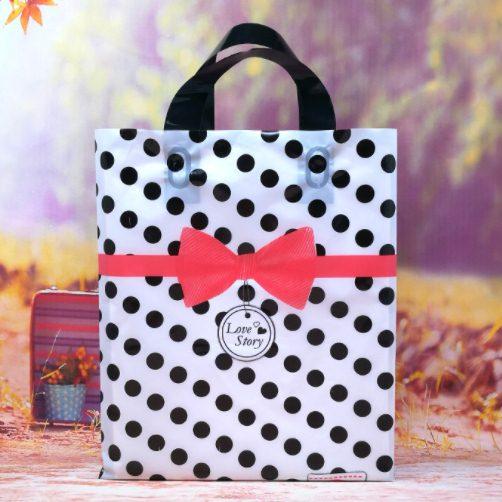 ถุงกระเป๋าขยายข้างสีขาวจุดดำคาดโบว์ 25x35x7 cm. 50 ชิ้น